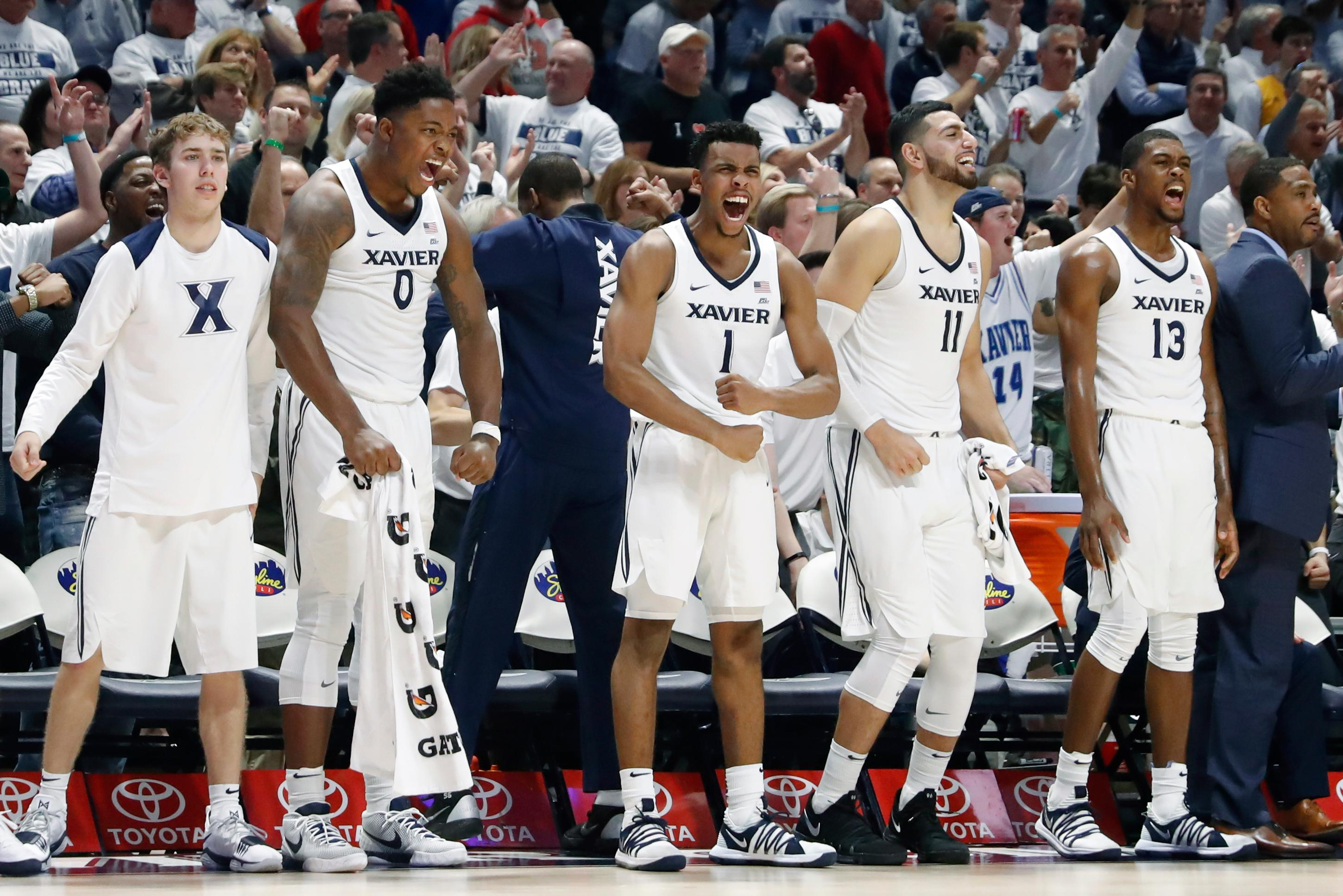 The Xavier bench reacts in the second half of an NCAA college basketball game against Cincinnati, Saturday, Dec. 2, 2017, in Cincinnati. Xavier won 89-76. (AP Photo/John Minchillo)