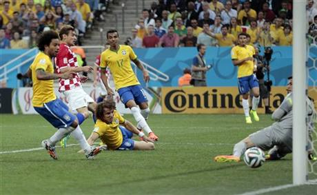 Brazil's Marcelo, left, scores on his own goal past Brazil's goalkeeper Jefferson while trying to clear the ball during the group A World Cup soccer match between Brazil and Croatia.