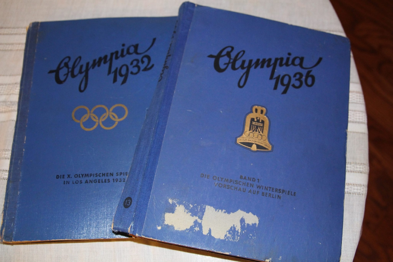 The books are interesting. They were published in Germany for the 32 LA and 36 Berlin games. They were unique because the book was published with space for photos and then the buyer had to paste the photos into the appropriate spot. The books have photos of some of the greatest athletes of all time, Babe Didrikson in 1932 and Jesse Owens in 1936. 7/22/2016 (Larry | KSNV)