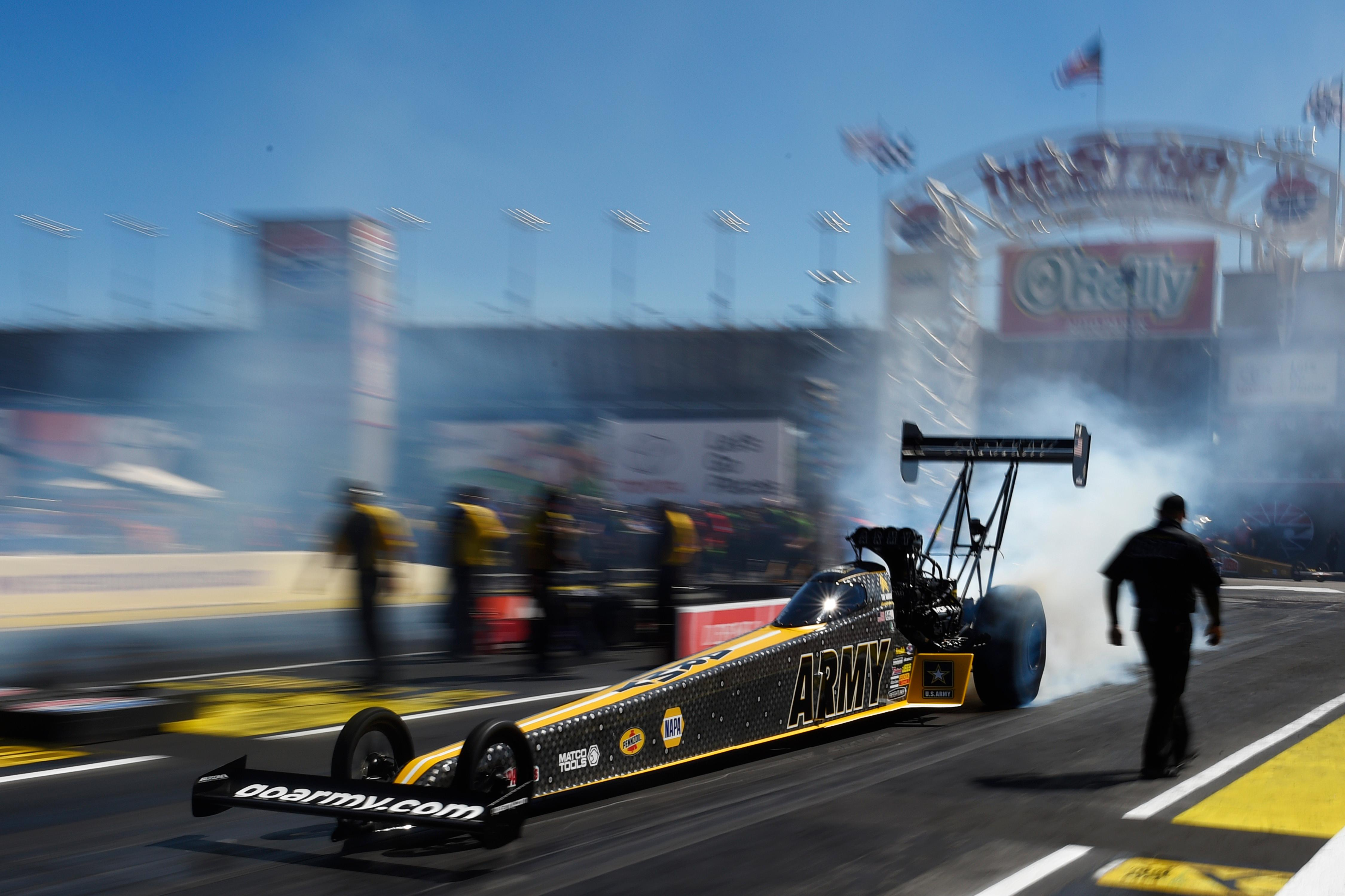 Tony Schumacher smokes his tires during the NHRA DENSO Spark Plug Nationals at The Strip at the Las Vegas Motor Speedway Sunday, April 2, 2017. (Sam Morris/Las Vegas News Bureau)
