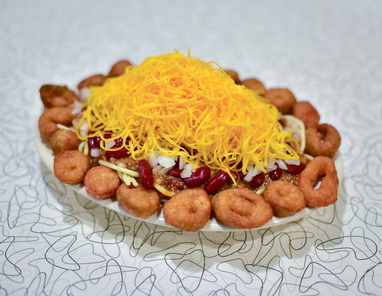 6-Way: chili on spaghetti, cheese, onions, red beans, and fried jalapenos / Image: Phil Armstrong, Cincinnati Refined // Published: 1.16.17