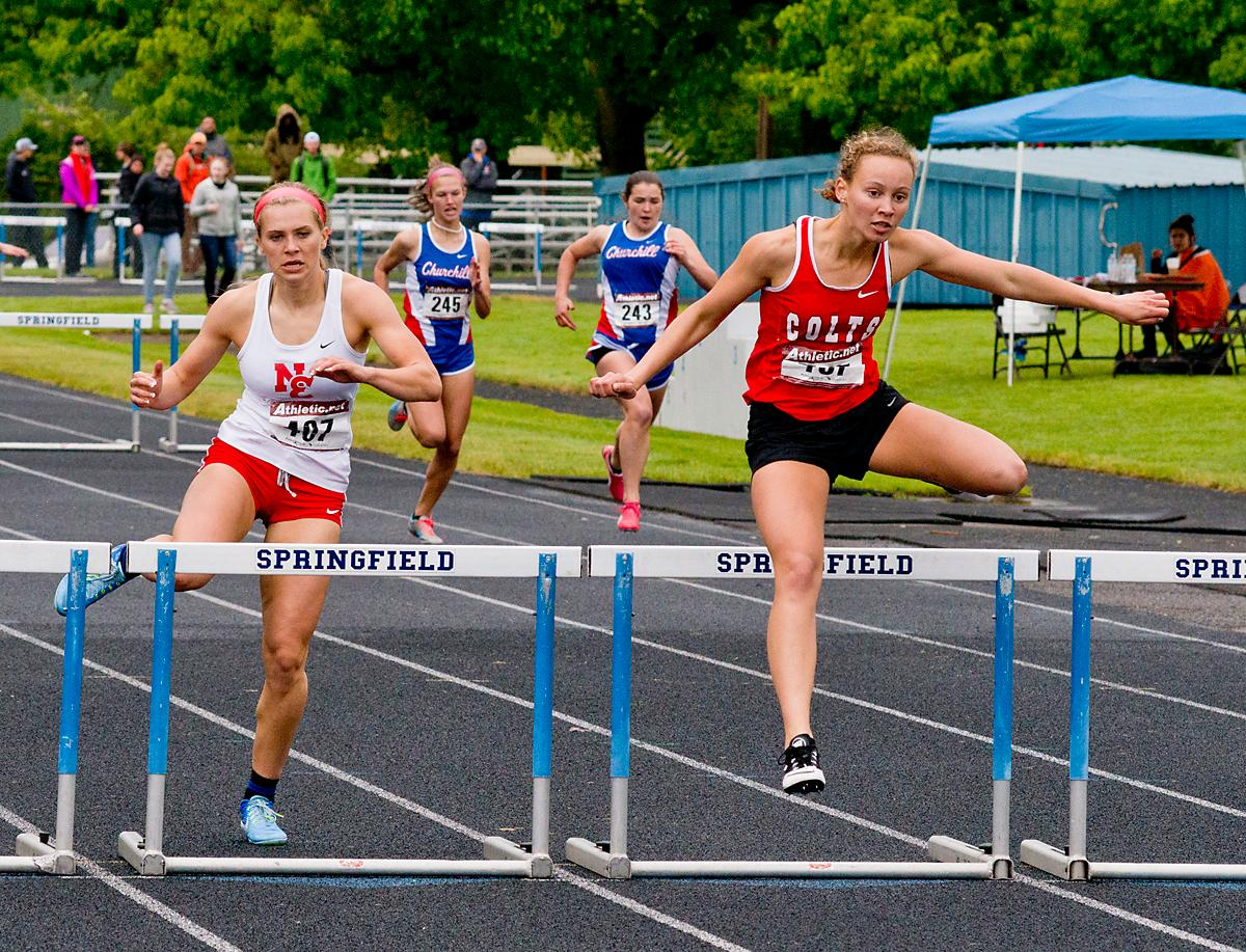Tara Crosswhite from Thurston wins the 300 meter hurdles with a time of 45.68 at the 5A-3 Midwestern League District Track Meet. Photo by Dan Morrison, Oregon News Lab