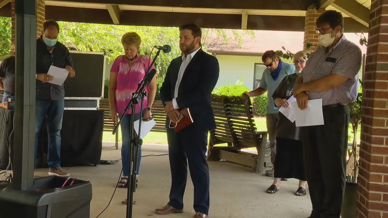 A group, including Canton town leaders, held a prayer vigil at Silver Bluff Village nursing home. (Photo credit: WLOS staff)