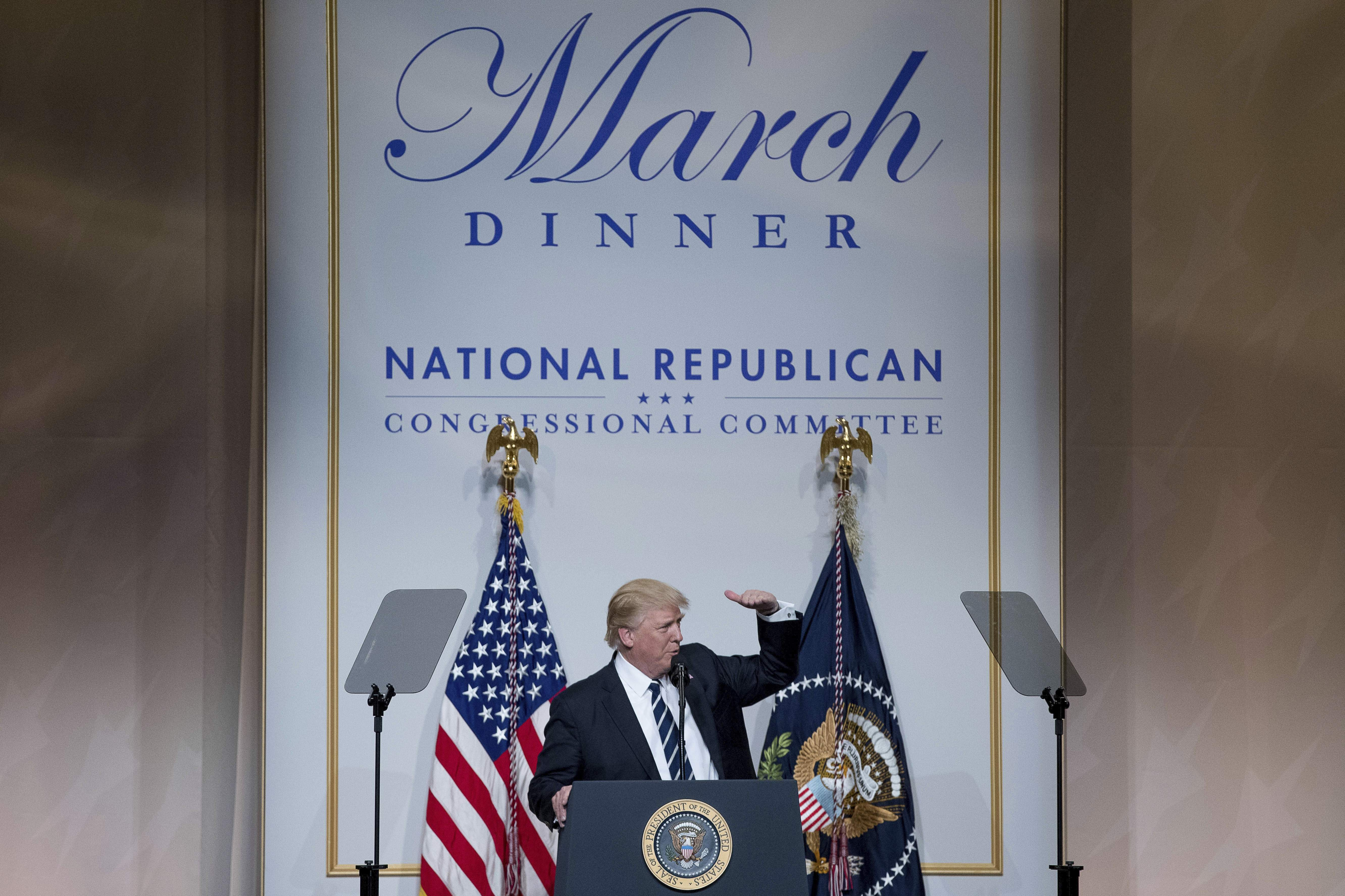 DAY 61 - In this March 21, 2017, file photo, President Donald Trump speaks at the National Republican Congressional Committee March Dinner at the National Building Museum in Washington. (AP Photo/Andrew Harnik, File)