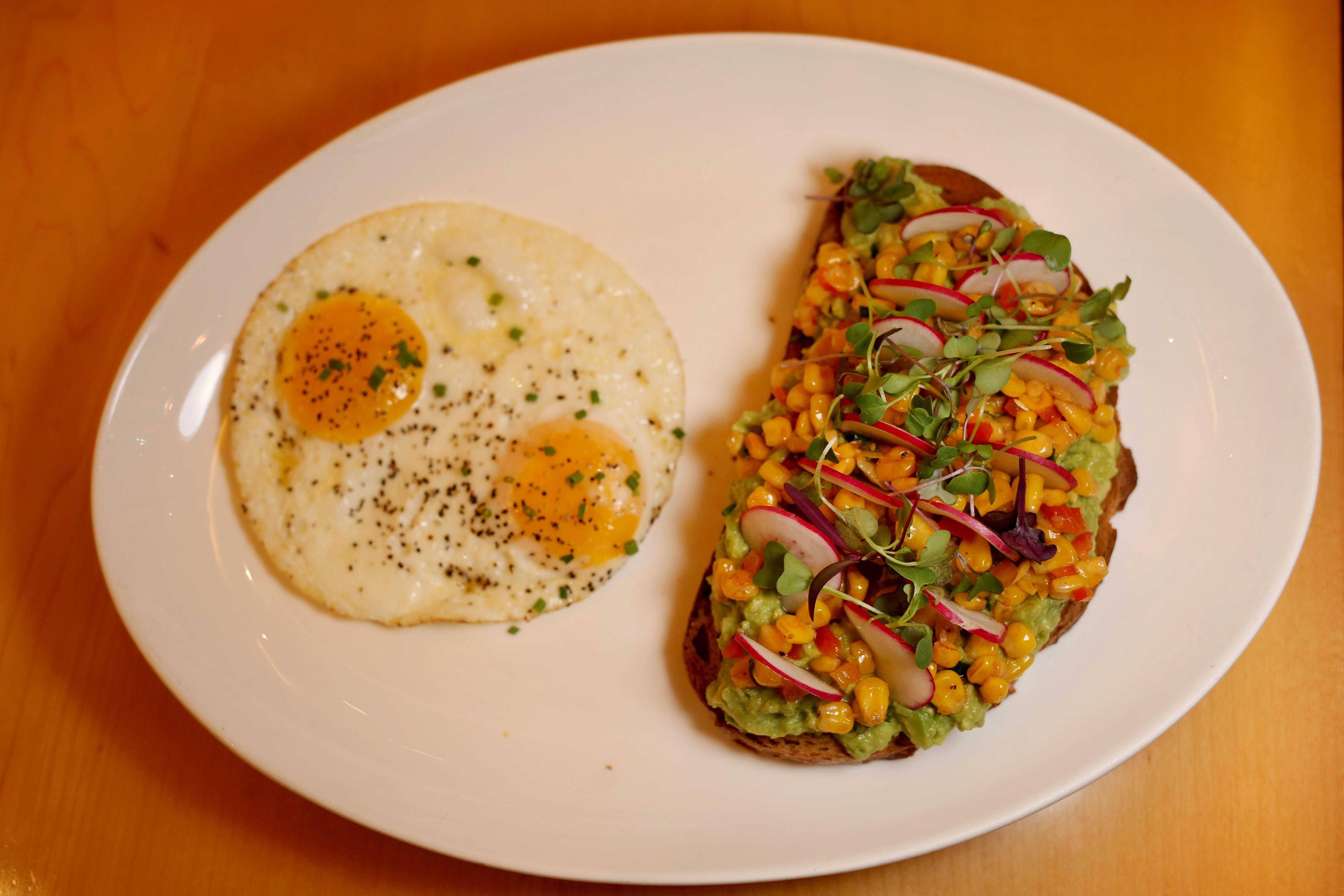 This may be one of the most elaborate versions of avocado toast. It's only available during brunch on weekends, but it comes with corn, micro greens, radish and red bell pepper on 7-grain toast. Although the price is listed at $14, you can order a full brunch meal for just a few extra bucks and pick the avocado toast option. Paired with their $15 bottomless mimosas and bellinis, it's a substantial brunch option. (Amanda Andrade-Rhoades/DC Refined)