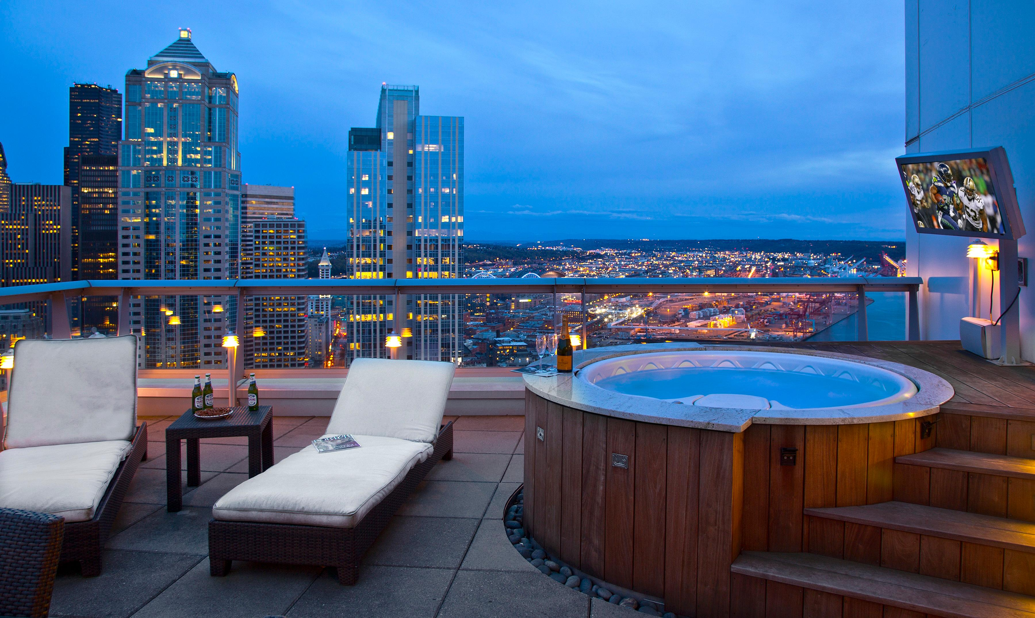 This beautiful Belltown penthouse is 2,453 square feet of PURE luxury. The home has 2 bedrooms and 1.75 bathrooms, but the biggest pull (in my opinion), is the hot tub on the private patio overlooking the city. The condo is selling by Scott Richards of Windermere for $4,500,000, more info at SeattlePointOfView.com. (Image: Michael Walmsley)