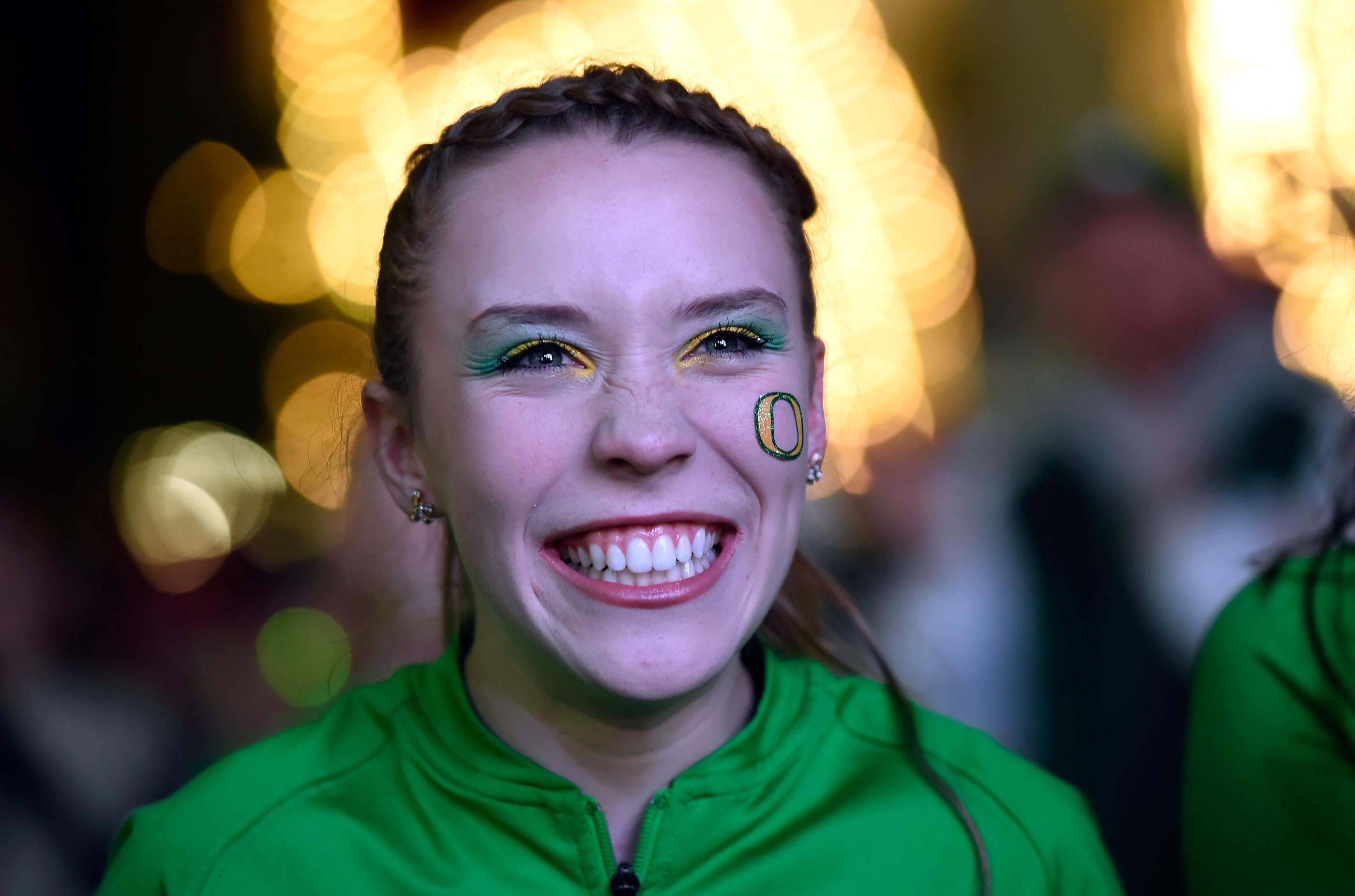 Oregon color guard member Rebecca Mayer smiles as she participates during a pep rally at the Fremont Street Experience Friday, Dec. 15, 2017, in Las Vegas. The Boise State Bronco will take on the Oregon Ducks in the 26th edition of the Las Vegas Bowl at Sam Boyd Stadium on Saturday. CREDIT: David Becker/Las Vegas News Bureau
