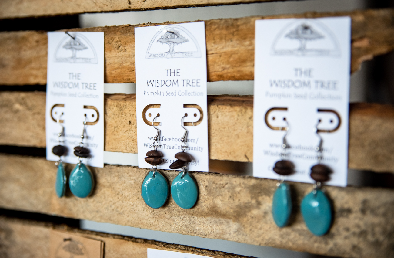 Painted pumpkin seed earrings made by{ }Di Del Pilar Cendales from her brand Wisdom Tree / Image: Melissa Sliney // Published: 6.26.19
