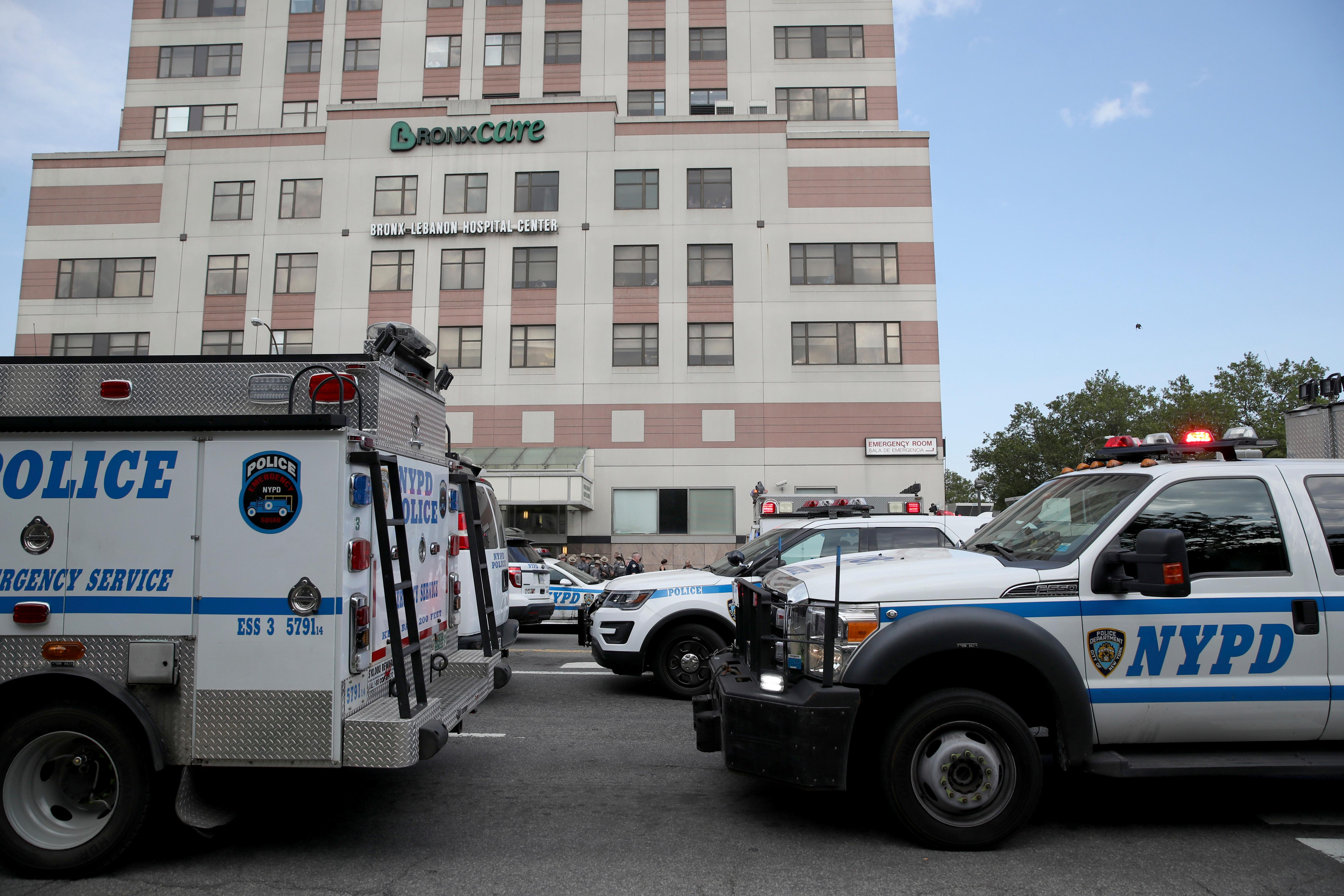 Police vehicles converge on Bronx Lebanon Hospital in New York after a gunman opened fire there on Friday, June 30, 2017. The gunman, identified as Dr. Henry Bello who used to work at the hospital, apparently took his own life after shooting others, authorities said. (AP Photo/Mary Altaffer)