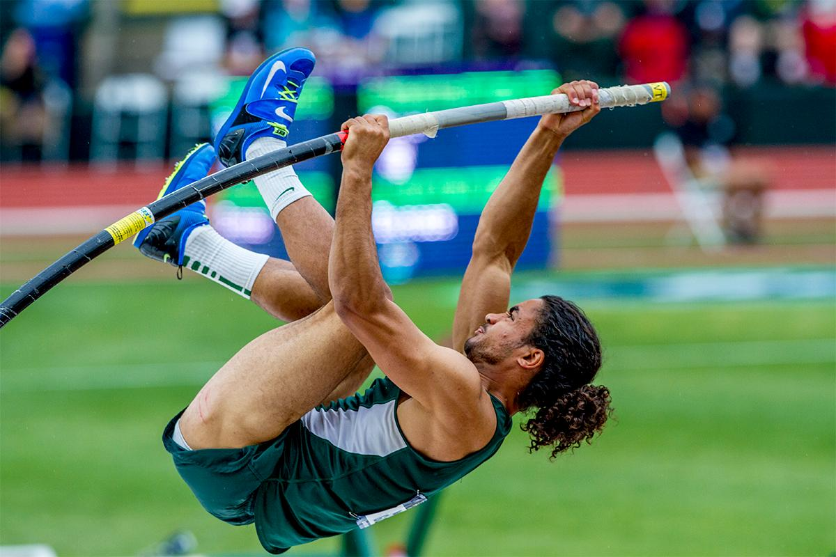 Michigan State's Noah Gary flings himself up and towards the bar. Gary would place 14th with a final height of 5.30 meters. Photo by August Frank, Oregon News Lab