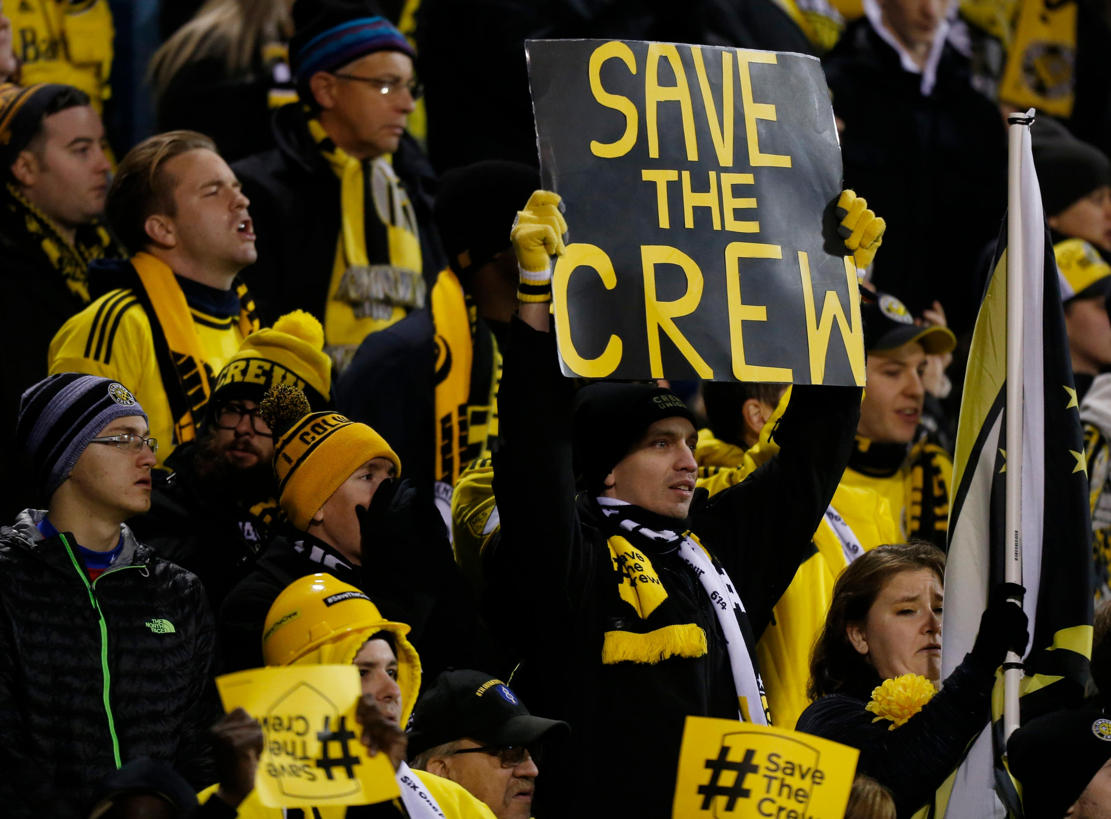 Columbus Crew fans show their support for their team as they play against Toronto FC during the first half of an MLS Eastern Conference championship soccer match Tuesday, Nov. 21, 2017, in Columbus, Ohio. The Crew's owner has recently threatened to move the team after the 2018 season. (AP Photo/Jay LaPrete)