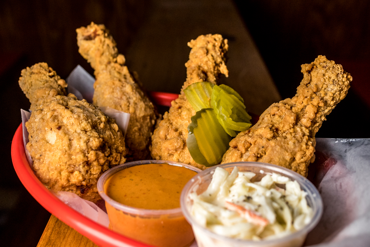 Four drumsticks served with coleslaw, pickles, and Galactic Sauce / Image: Catherine Viox{ }// Published: 7.9.20