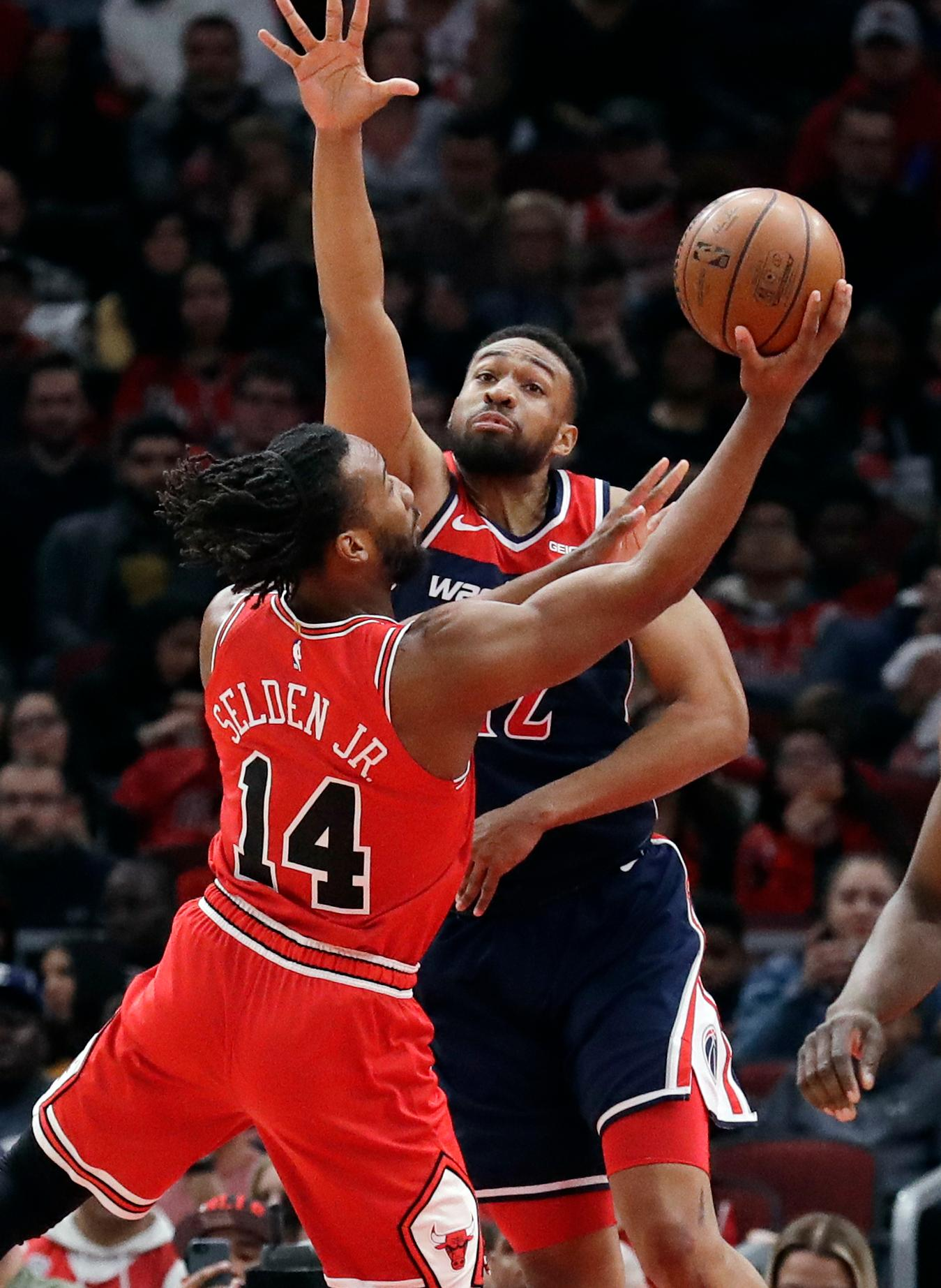 Washington Wizards forward Jabari Parker, right, guards Chicago Bulls' Wayne Selden Jr. during the first half of an NBA basketball game Wednesday, March 20, 2019, in Chicago. (AP Photo/Nam Y. Huh)