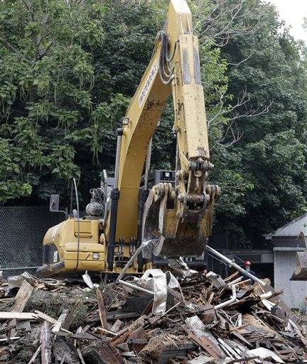 The house where three women were held captive and raped for more than a decade is demolished.