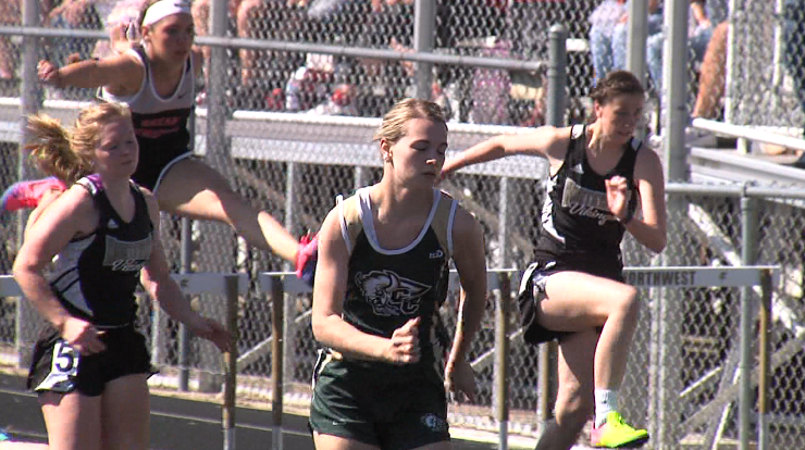 Central City's Erica Stuart (center) has a healthy lead on the field before winning the girls 100 meter hurdles at the Dave Gee Invite, hosted by Northwest High School, April 20, 2017 (NTV News)