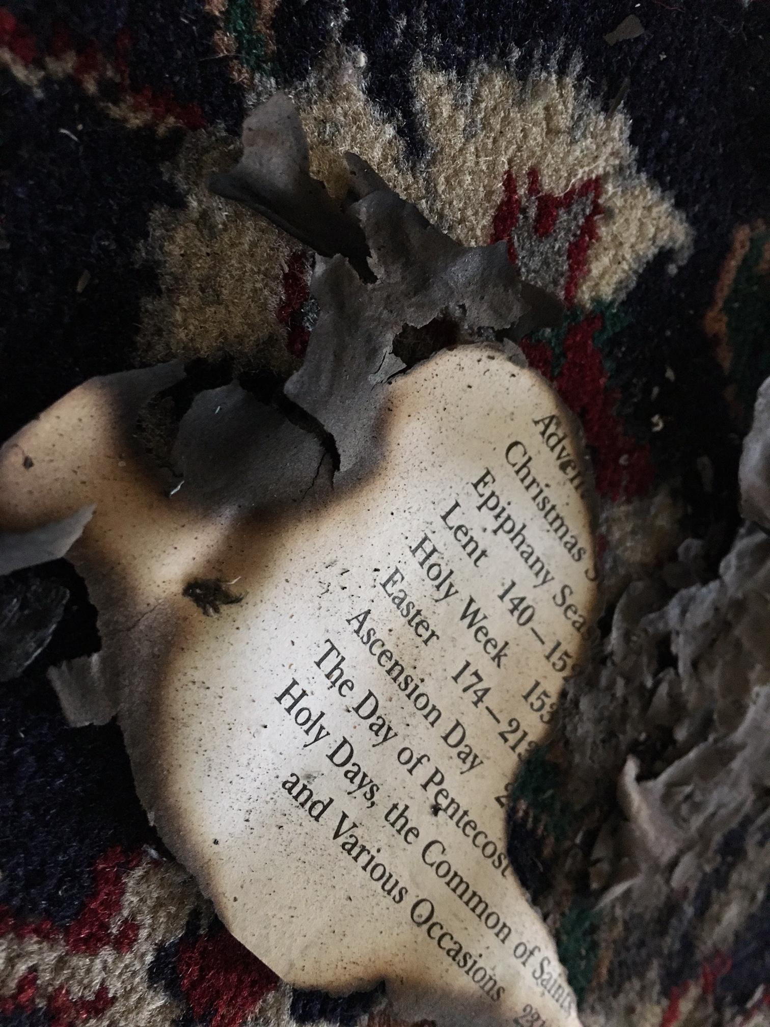 Charred scripture remains from altar fire at St. John's Episcopal Church. (WCHS/WVAH)