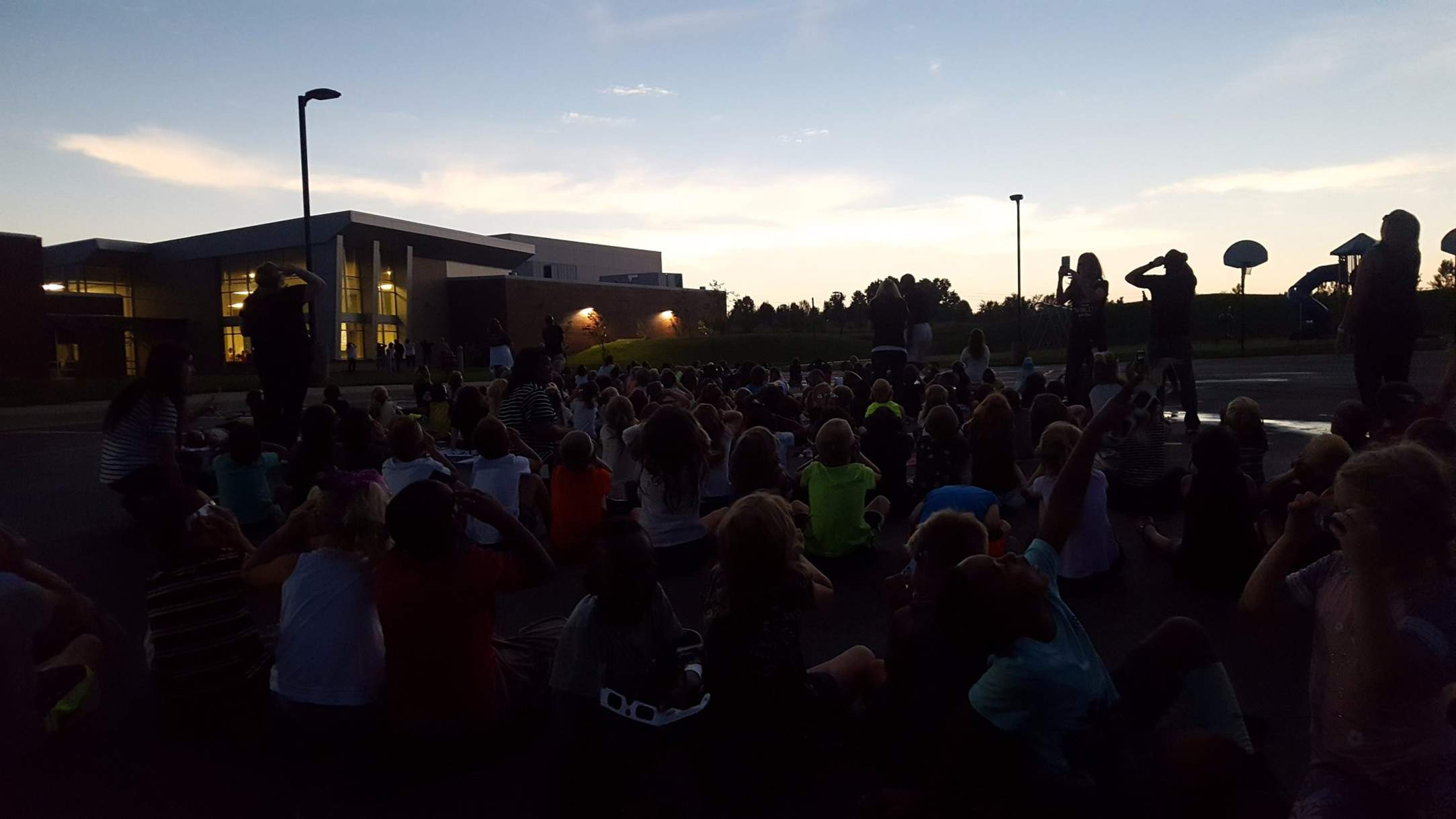 Students at Cordill-Mason Elementary in Blue Springs enjoying the eclipse and the drakness during totality. [Photo courtesy of Blue Springs School District]