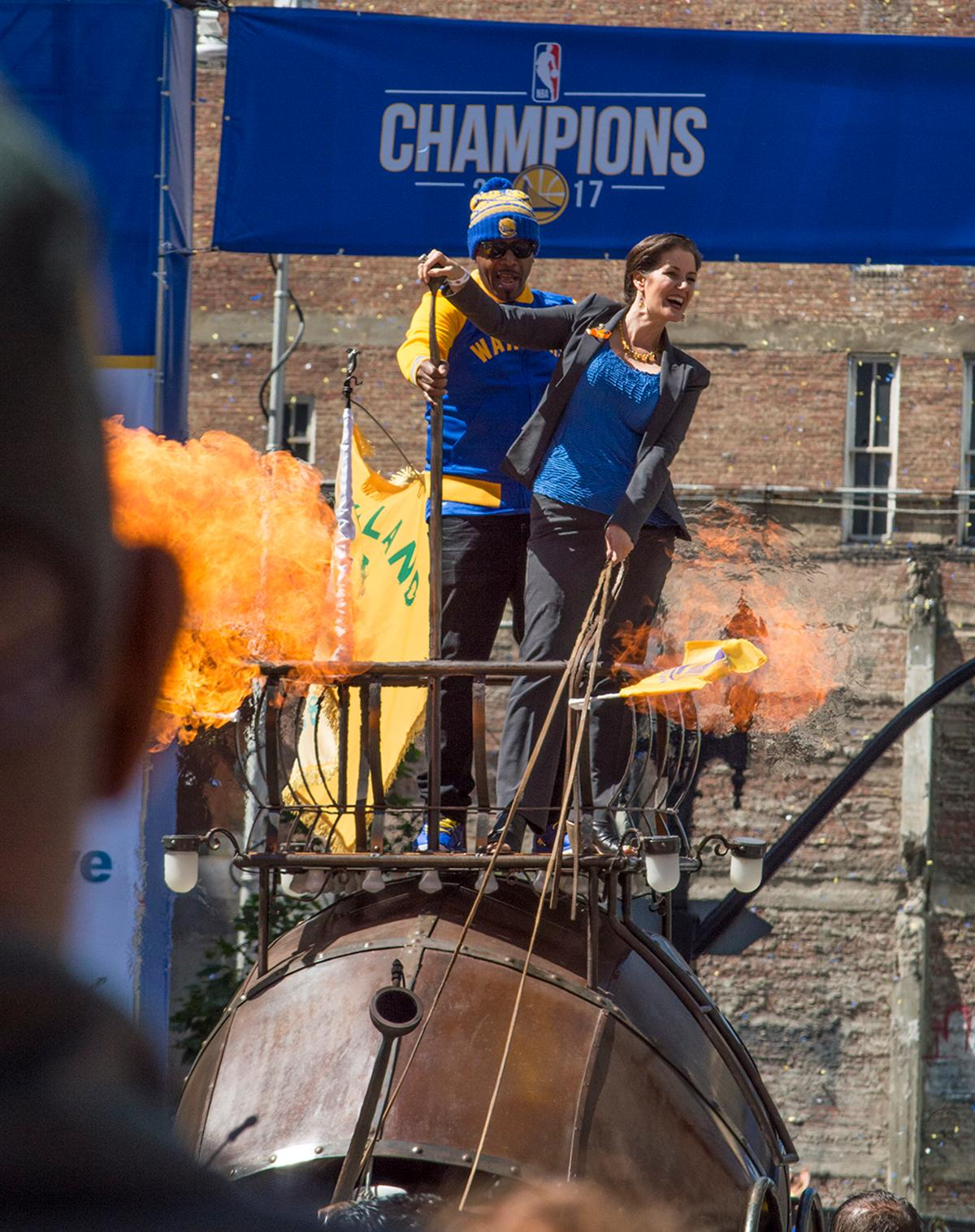 Mayor of Oakland, Libby Schaaf, greets the crowd atop a float of flames in the Golden State Warriors victory parade. Photo by Emily Gonzalez, Oregon News Lab.