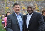 FOX 11 Sports' Drew Smith and Packers Hall of Famer Johnnie Gray pose at Lambeau Field before they take the microphones for Packers Family Night, Aug. 8, 2015.