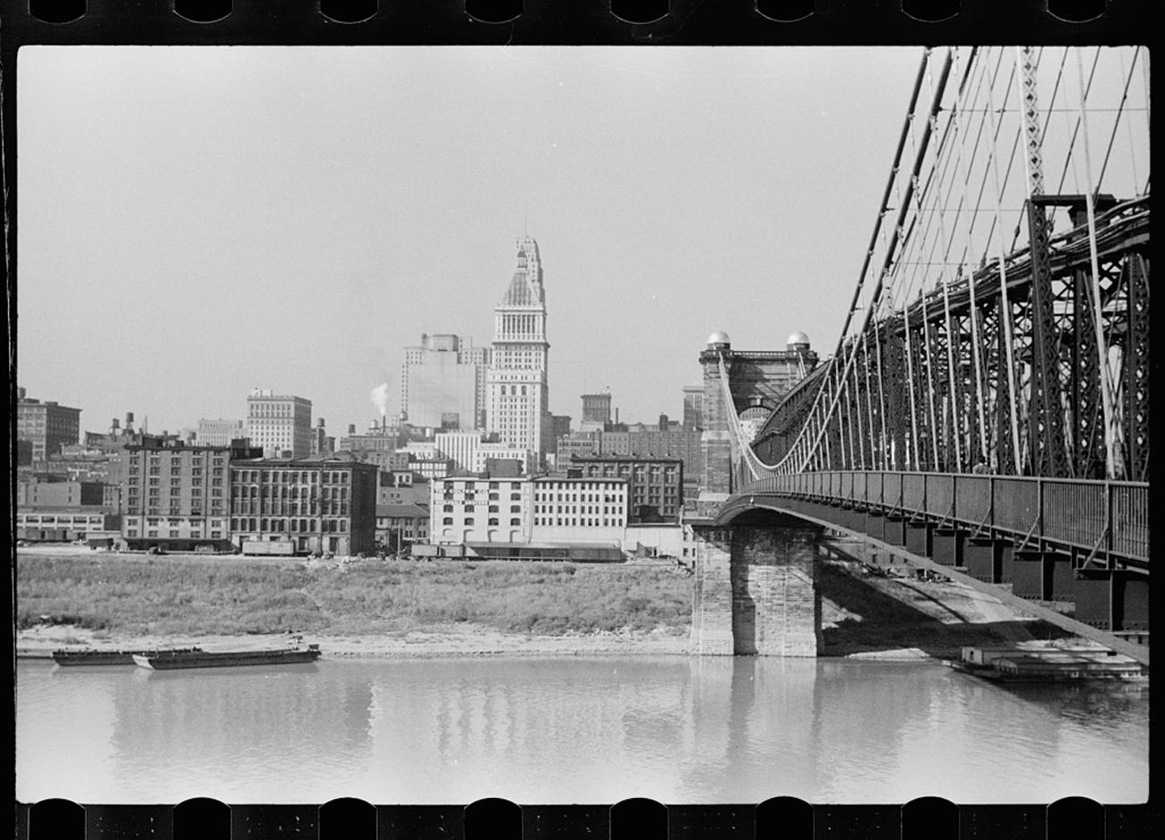 An untitled photo of Cincinnati's riverfront in September of 1939.{ }Cincinnati, like any major city, has been on a forward track of dynamic development from year to year. New buildings are added while others are demolished, and it's interesting to reflect upon the ever-changing landscape. Comparing old and new photos best illustrates how different (or similar) things may look today from when they were originally constructed. / Image: John Vachon for the U.S. Farm Security Administration/Office of War Information accessed via the Library of Congress Archives // Published: 3.4.19