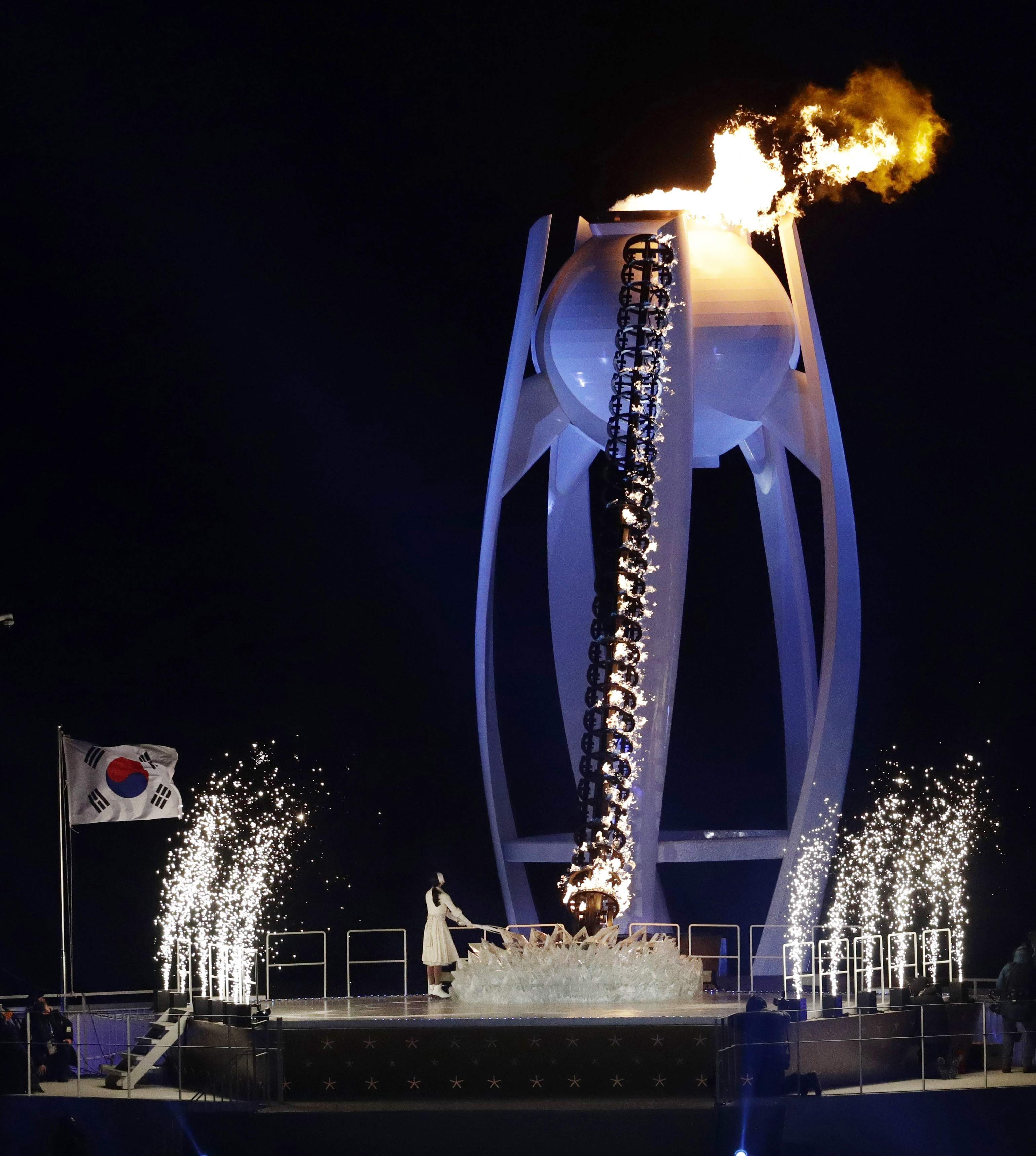Yuna Kim, former South Korean figure skater lights the Olympic cauldron during the opening ceremony of the 2018 Winter Olympics in Pyeongchang, South Korea, Friday, Feb. 9, 2018. (AP Photo/Charlie Riedel)