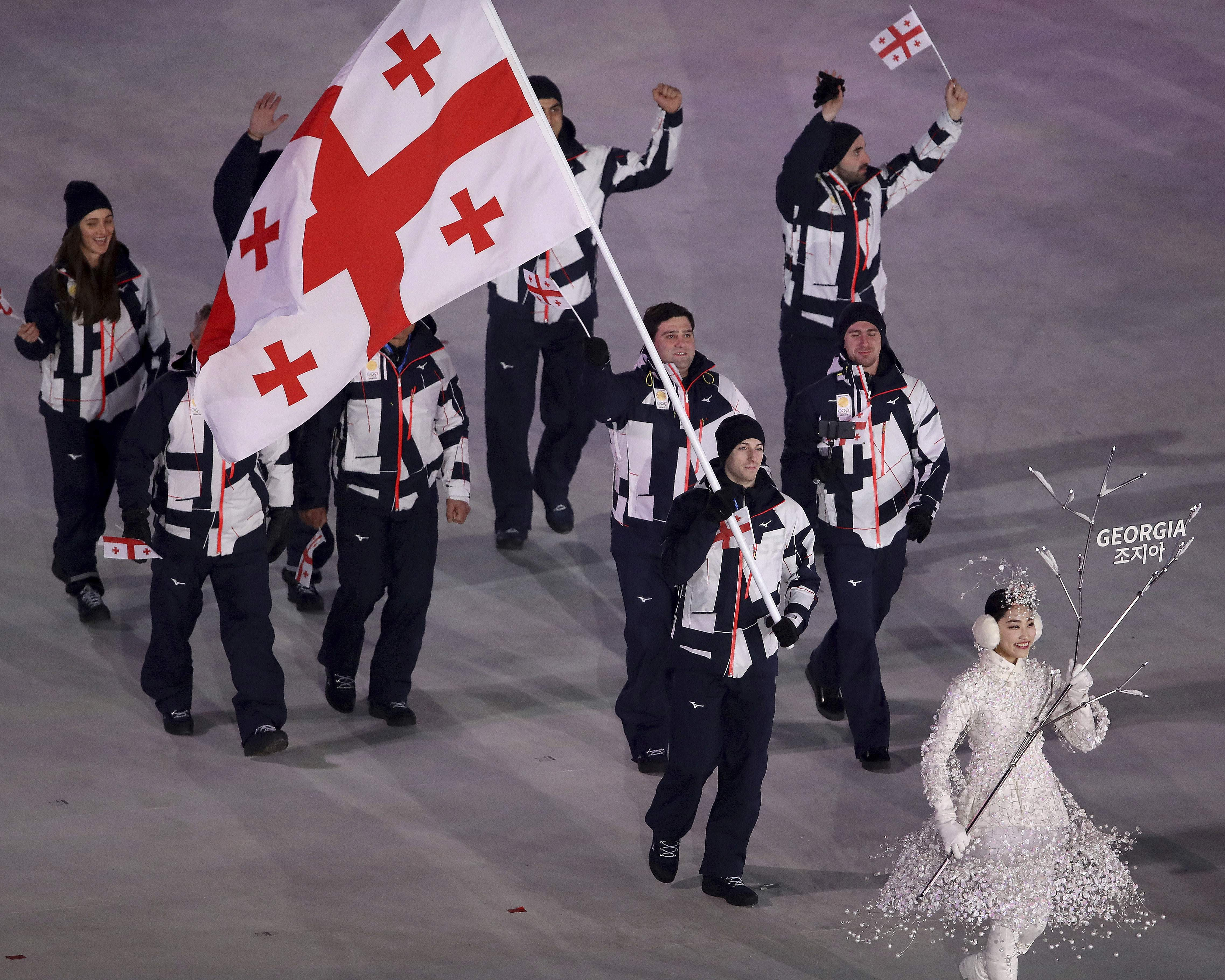 Morisi Kvitelashvili carries the flag of Georgia during the opening ceremony of the 2018 Winter Olympics in Pyeongchang, South Korea, Friday, Feb. 9, 2018. (Sean Haffey/Pool Photo via AP)
