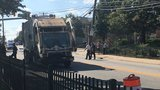 Woman struck, killed by garbage truck