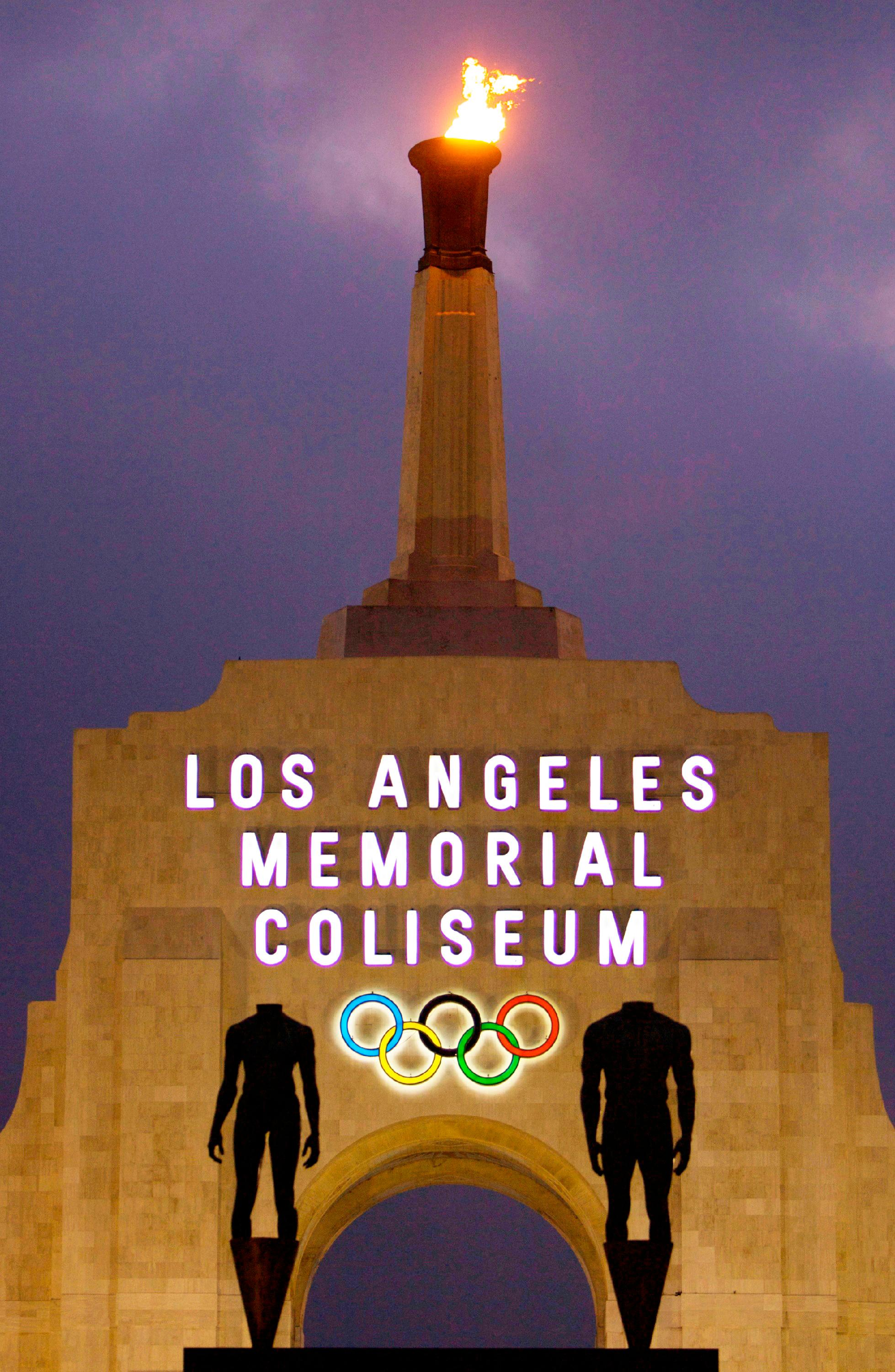 FILE - In this Feb. 13, 2008, file photo is the facade of Los Angeles Memorial Coliseum in Los Angeles. (AP Photo/Damian Dovarganes, File)