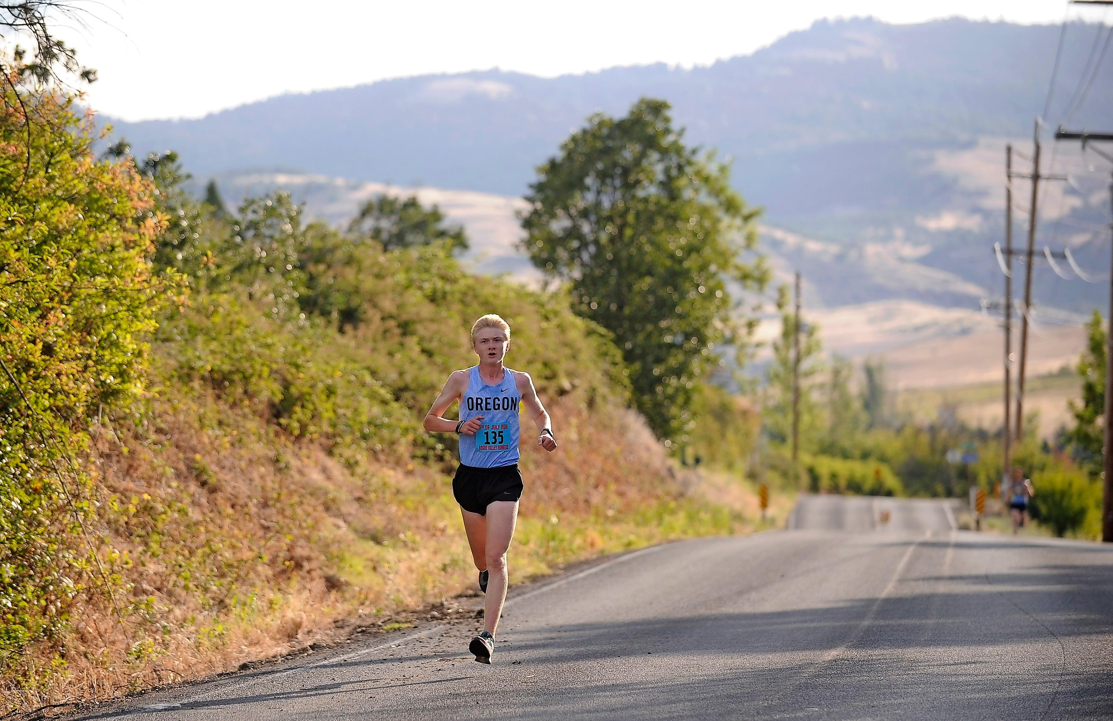 Andy Atkinson/Daily Tidings<br>E.J. Holland makes his way to the turn-around winning the Ashland  4th of July Run 10k Wednesday morning.