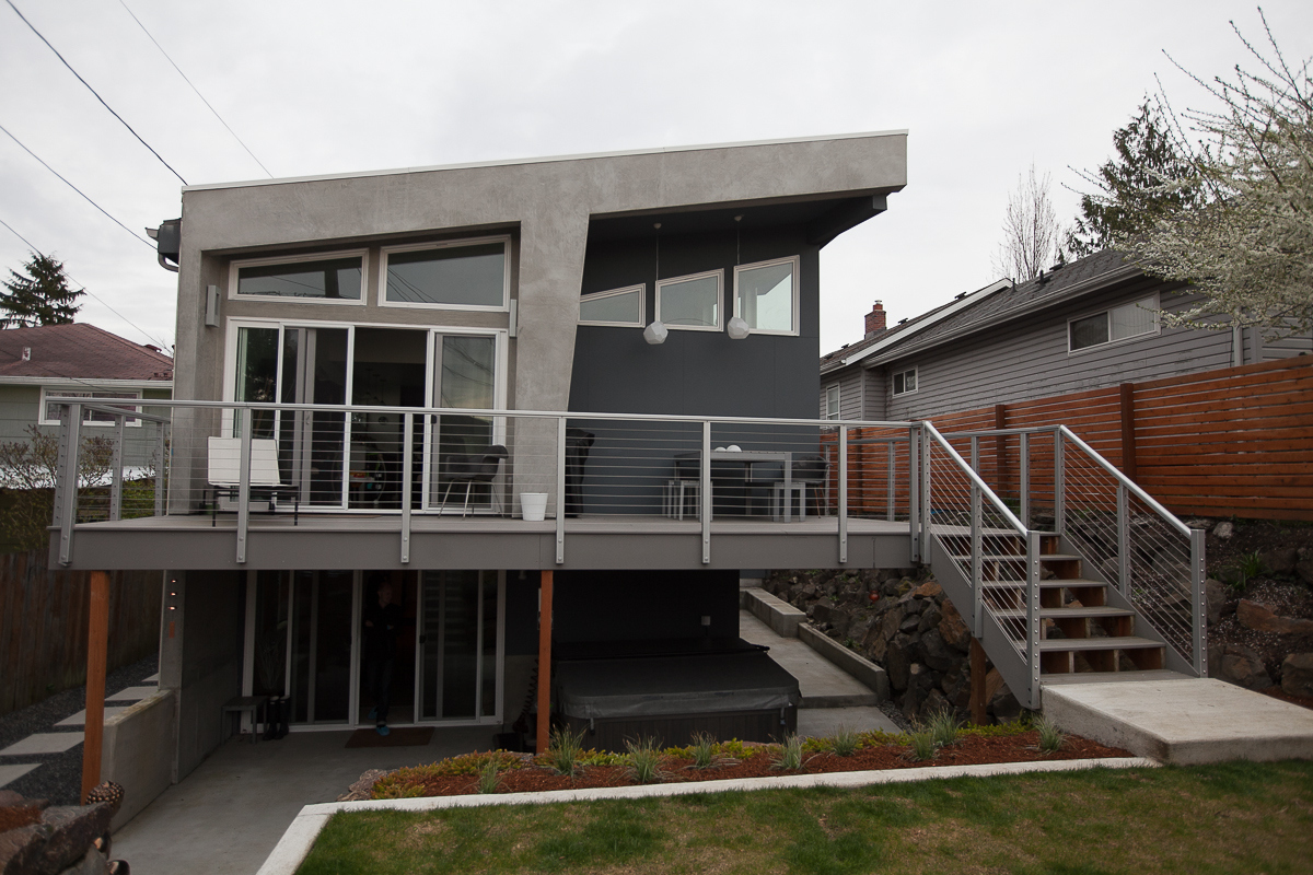 This 3 bedroom 3.5 bathroom West Seattle home was originally built in 1952, with massive rennocvations and additional square feet added later. Made to accentuate light in it's every form, this house has a daylight basement, outdoor living spaces, and an unobstructed view of the sky from the living room. Architecture was a collaboration by