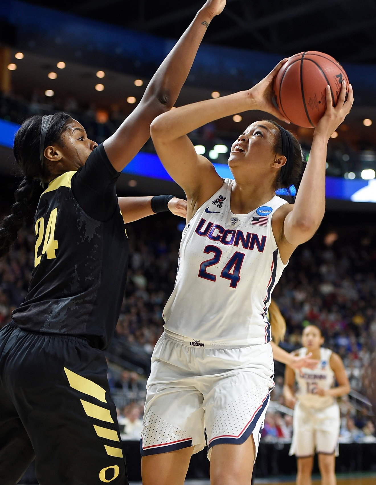 Connecticut's Napheesa Collier, right, shoots as Oregon's Ruthy Hebard, left, defends, during the first half of a regional final game in the NCAA women's college basketball tournament, Monday, March 27, 2017, in Bridgeport, Conn. (AP Photo/Jessica Hill)