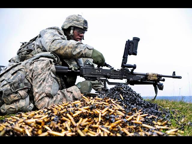 U.S. Army Spc. Kodi T. Lindsey and a fellow soldier correct the action of an M240B machine gun during a combined-arms, live-fire exercise on the 7th Army Joint Multinational Training Command's Grafenwoehr and Hohenfels training areas in Germany, March 28.