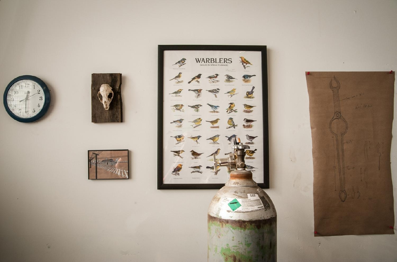 A sketch of Gilsdorf's current project, a commission for fireplace tongs, hangs on the wall. Gilsdorf is also a bird enthusiast and history buff with deep knowledge of Ireland, his ancestral homeland. / Image: Melissa Doss Sliney