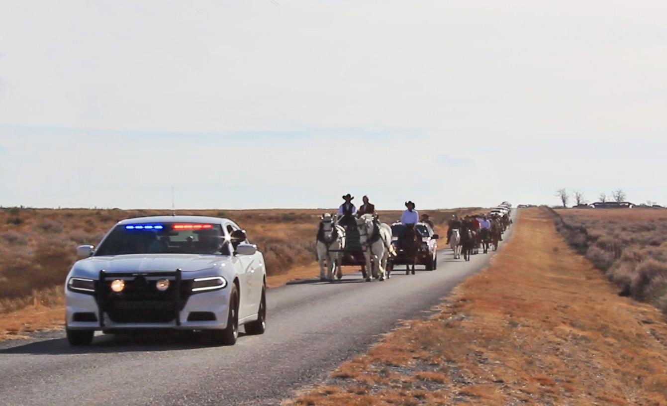 Friends, family and community members fulfilled a longtime Slapout, Oklahoma resident's wish to have a horseback funeral procession on Jan. 2. (Courtesy of Landon Nine)
