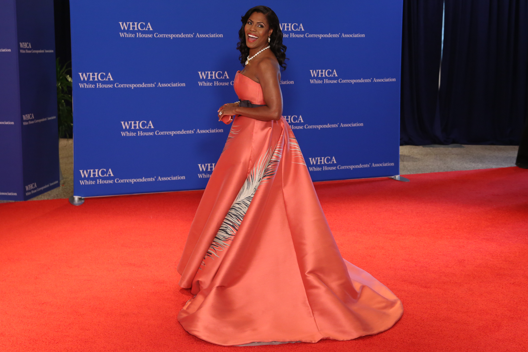 Omarosa may have been out of the White House before this dinner, but she came to the dinner dressed with a vengeance. That color is perfect on her skin and the silhouette is as dramatic as she was on The Apprentice. (Image: Amanda Andrade-Rhoades/ DC Refined)
