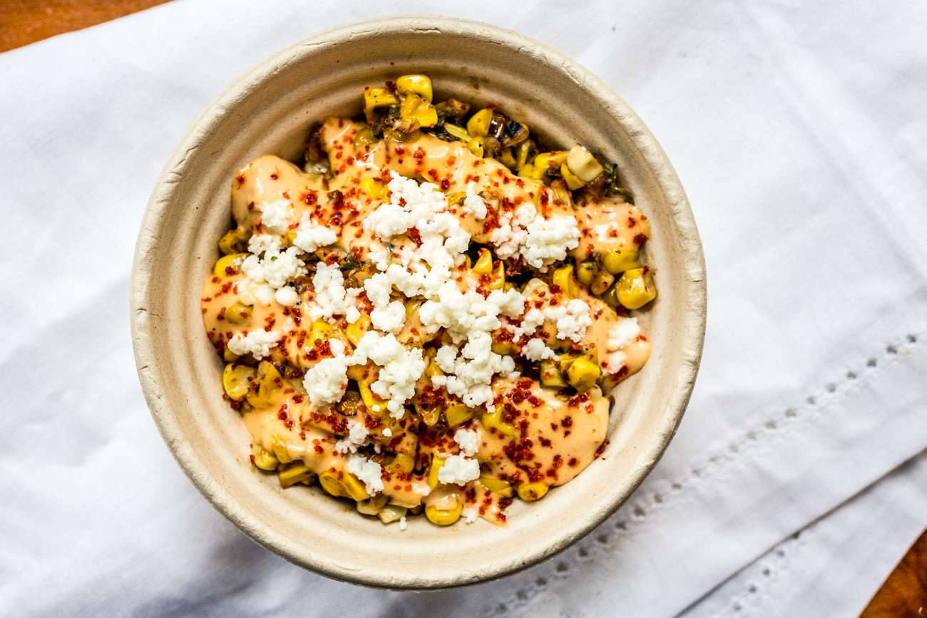 Esquites: shaved corn with epazote, poblana chilies, chipotle mayo, queso fresco, and Tajin seasoning /{ }Image: Catherine Viox{ }// Published: 8.31.19