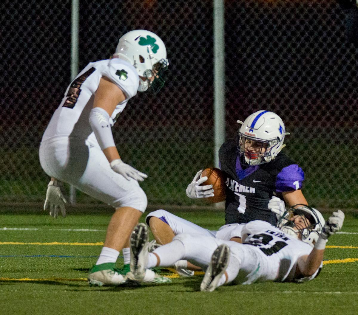 South Eugene Axemen wide receiver Elliot James (#1) falls to the ground after catching a long pass in the end zone for a score. Sheldon defeated South Eugene 63-6. Photo by Dan Morrison, Oregon News Lab