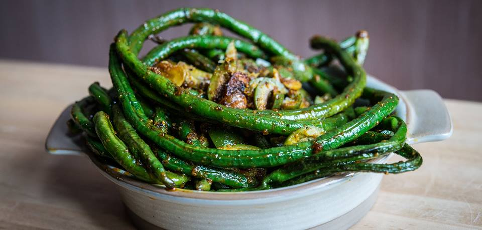 Chinese long beans with preserved lemon, garlic, and Castlevetrano olives. (Image: Sarah Flotard)