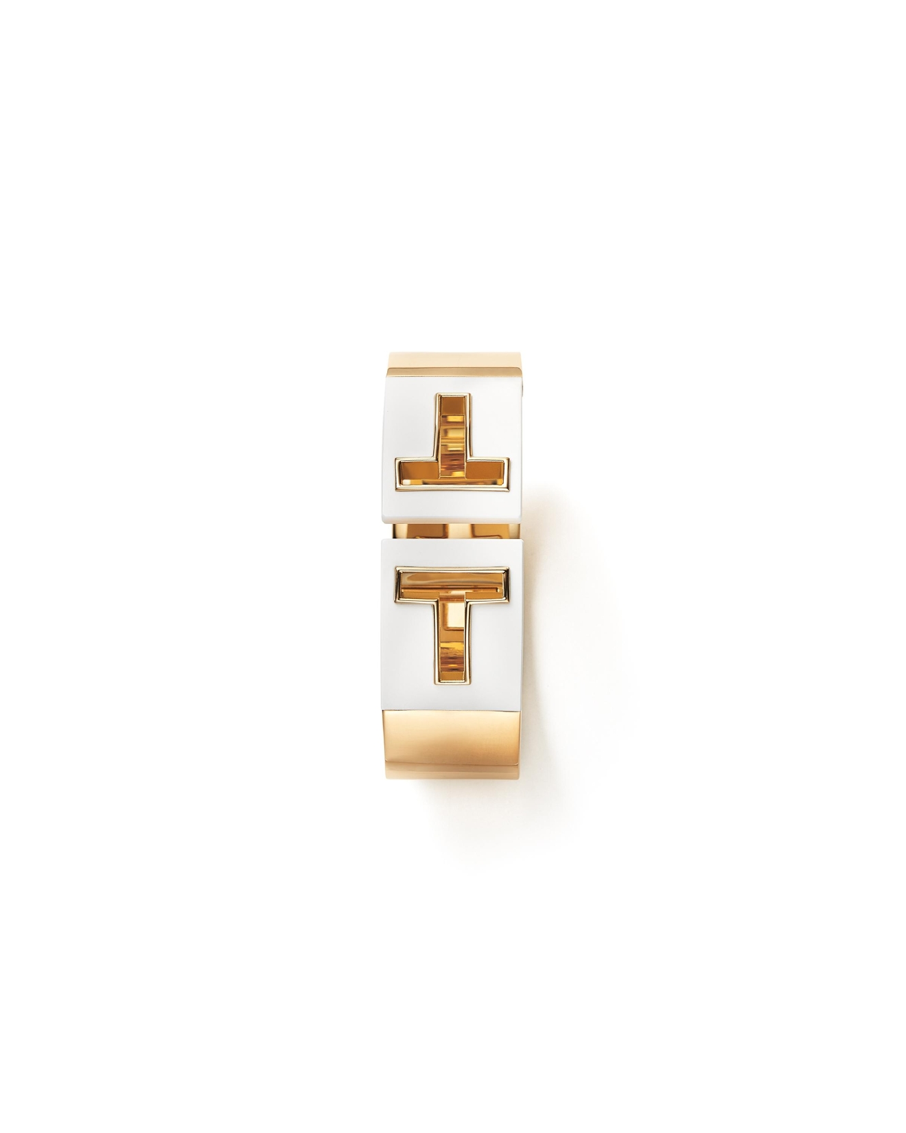 Tiffany T cutout hinged cuff in 18k gold with white ceramic, $8,500, Tiffany & Co., 8045 Leesburg Pike, Vienna, VA (Image: Courtesy Tiffany & Co.)