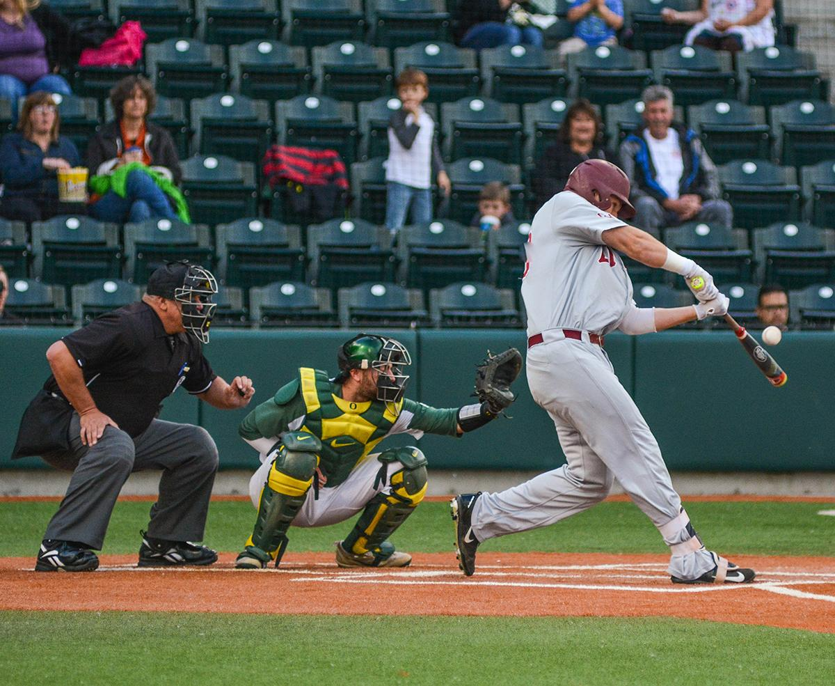 Lions Jamey Smart (#20) attempts to put the ball in play. On Wednesday night the Ducks fell to the Loyola Marymount Lions 4-0 at PK Park. Photo by Jacob Smith, Oregon News Lab