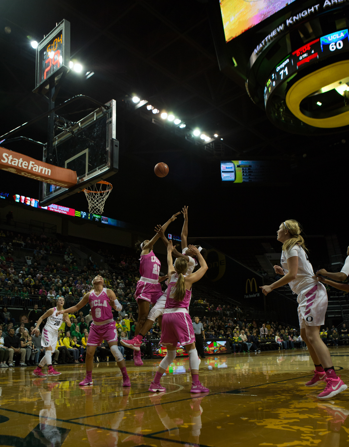 Oregon Ducks forward Ruthy Hebard (#24) shoots over a group of UCLA defenders. The Oregon Ducks defeated the No. 15 UCLA Bruins 84-75 Friday evening at Matthew Knight Arena in Eugene, Oregon.  Photo by Duncan Moore, Oregon News Lab