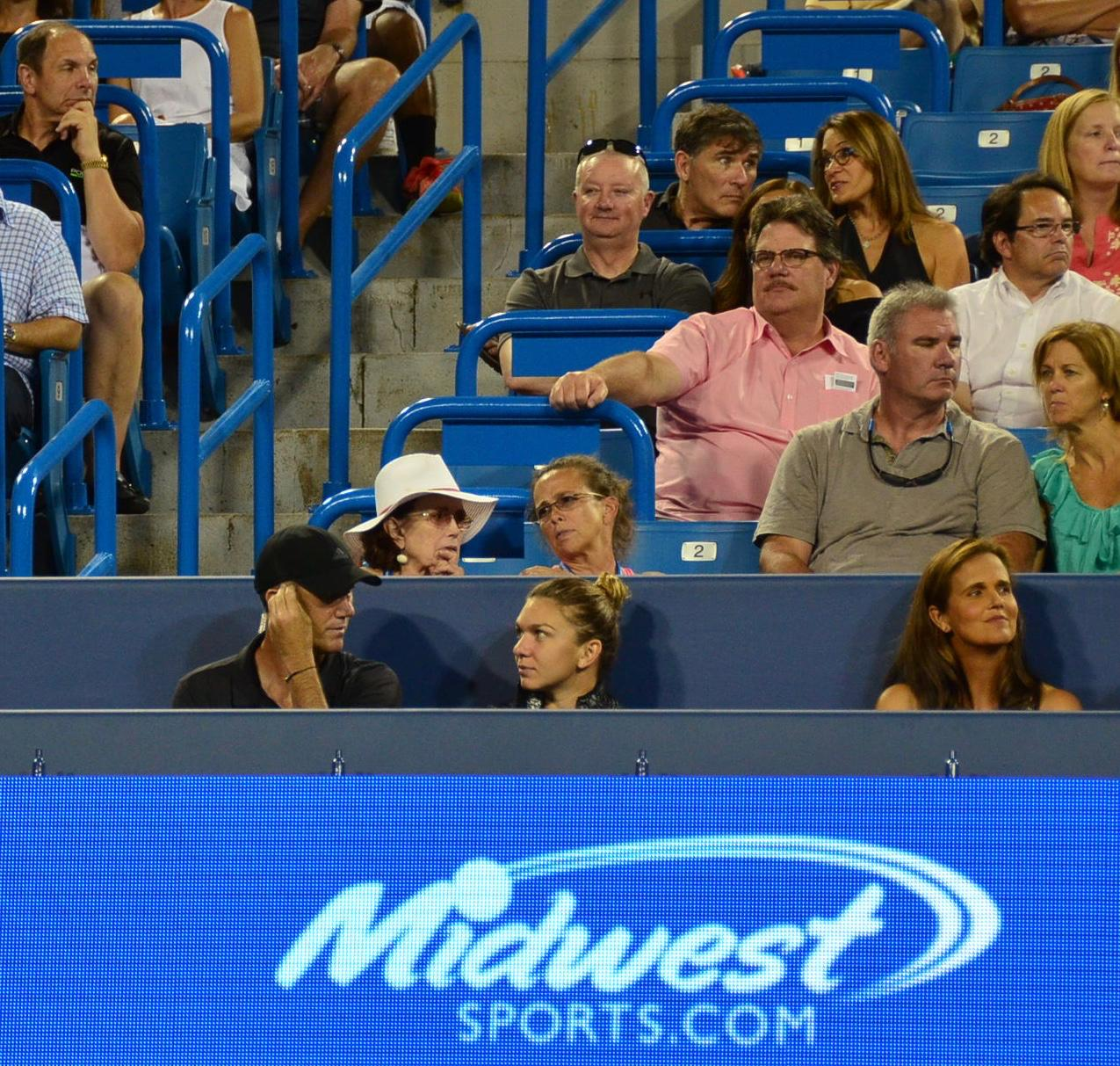 Darren Cahill and Simona Halep sitting on the court, taking in some of the men's matches / Image: Leah Zipperstein, Cincinnati Refined // Published: 8.21.17