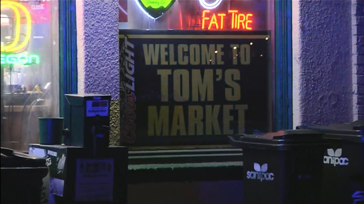 A robbery was reported at Tom's Market, 1490 E. 19th Avenue in Eugene, where authorities say a store employee was threatened with a handgun, March 5, 2018.  (SBG)