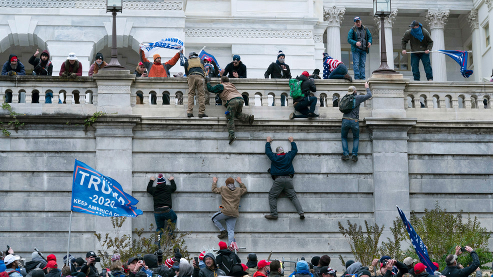 GALLERY: Pro-Trump protesters breach security, storm US Capitol