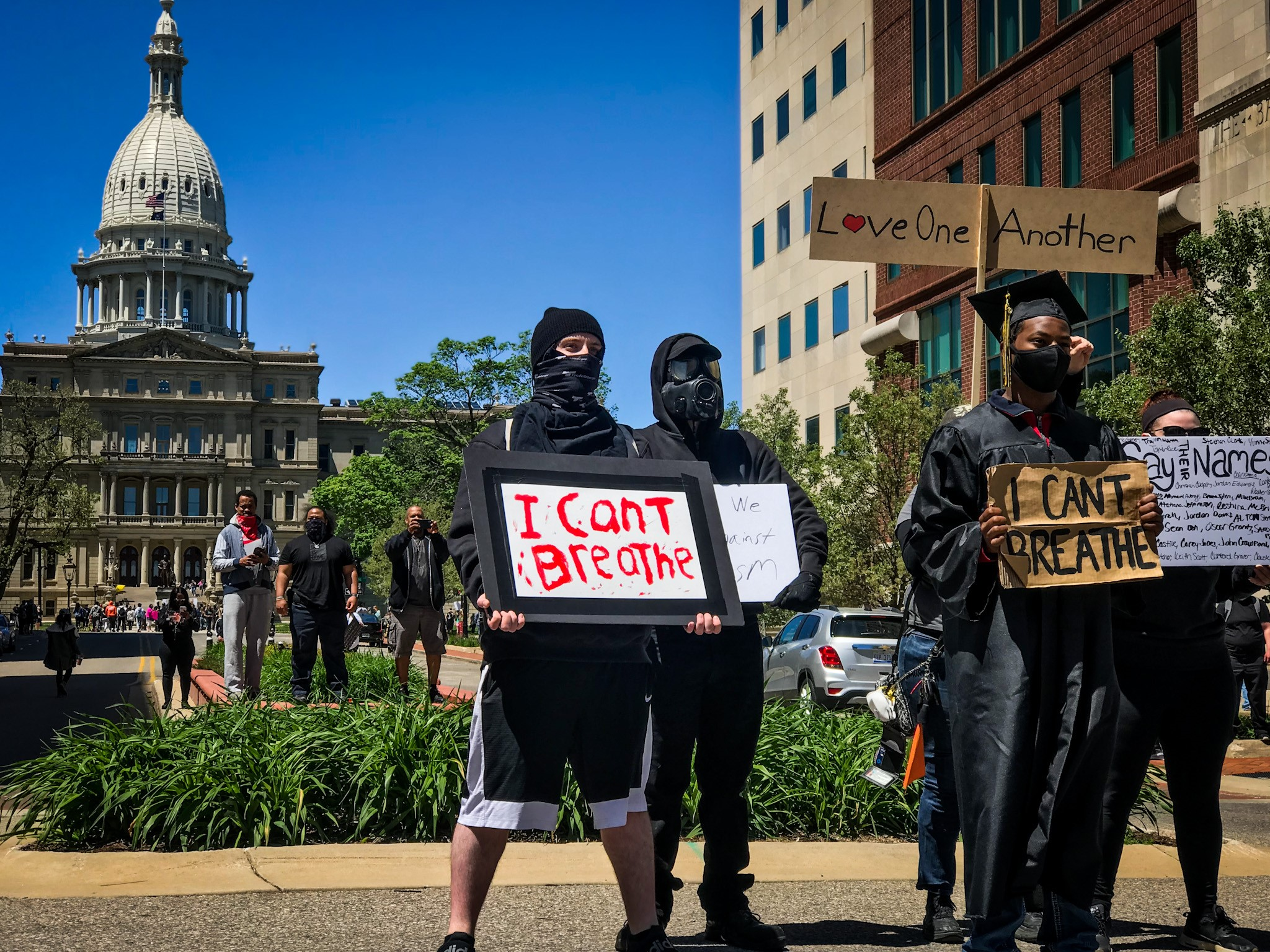 People gathered in Lansing on Sunday, May 31, 2020 to protest the death of George Floyd. This image was captured while the protest was peaceful before turning destructive as the night went on. (WWMT/Mikenzie Frost)