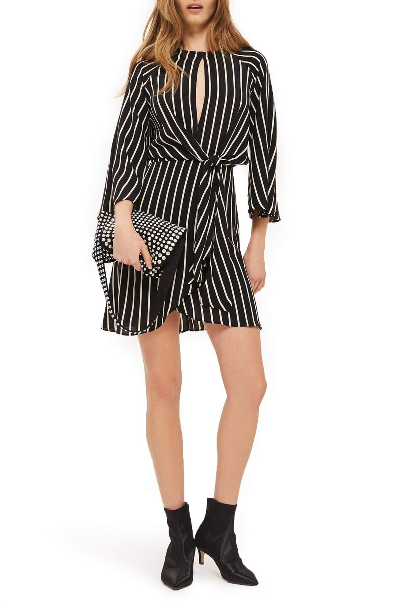 <p>More stripes please!{&nbsp;} Check out this Stripe Knot Front Minidress/TOPSHOP.{&nbsp;} Flowy drape and bold stripes are the design aesthetic of this raglan-sleeve dress with a tulip-style skirt and panels that gather to knot at the front waist. $90.00 at Nordstrom. (Image: Nordstrom){&nbsp;}</p><p></p>