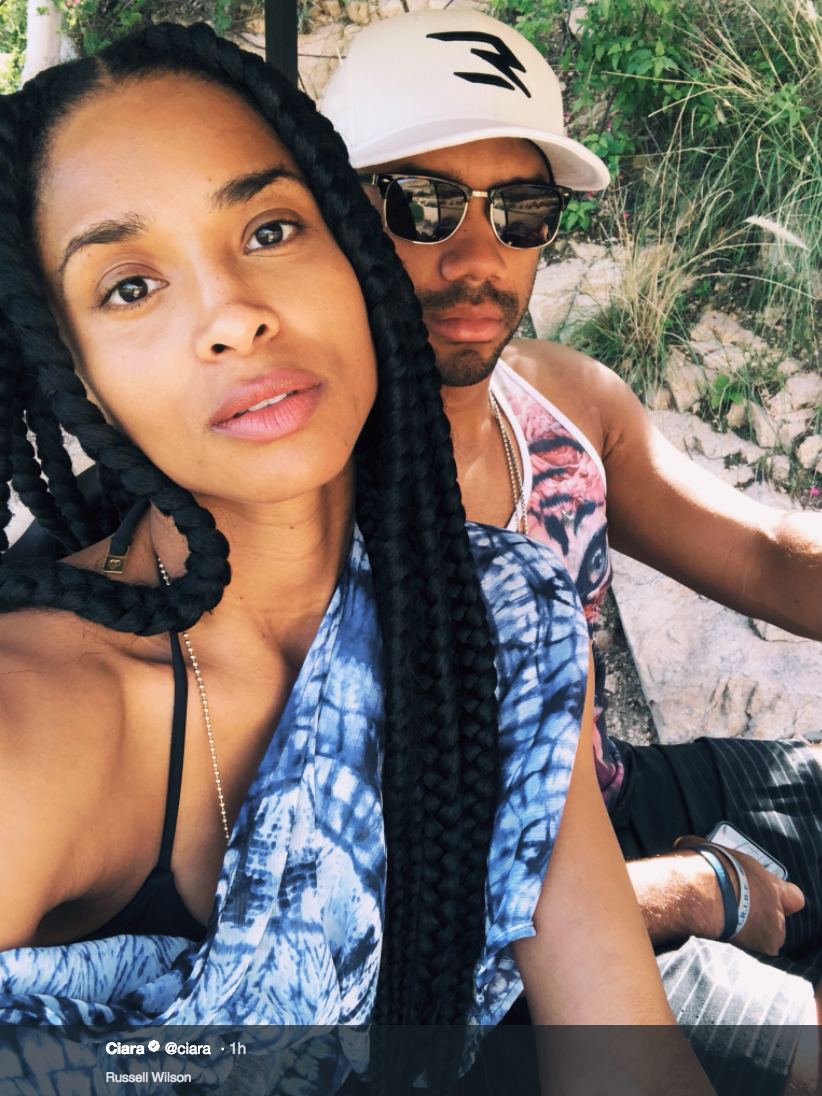 Ciara and Russell Wilson are on vacation somewhere, and steaming up the Internet with revealing photos! The beautifully shot photos are mainly portrait-style of Mrs. Wilson, shot by her husband. We don't know where this holiday is, but it's sure a vacation from clothes! (Image: @ciara / twitter.com/ciara)