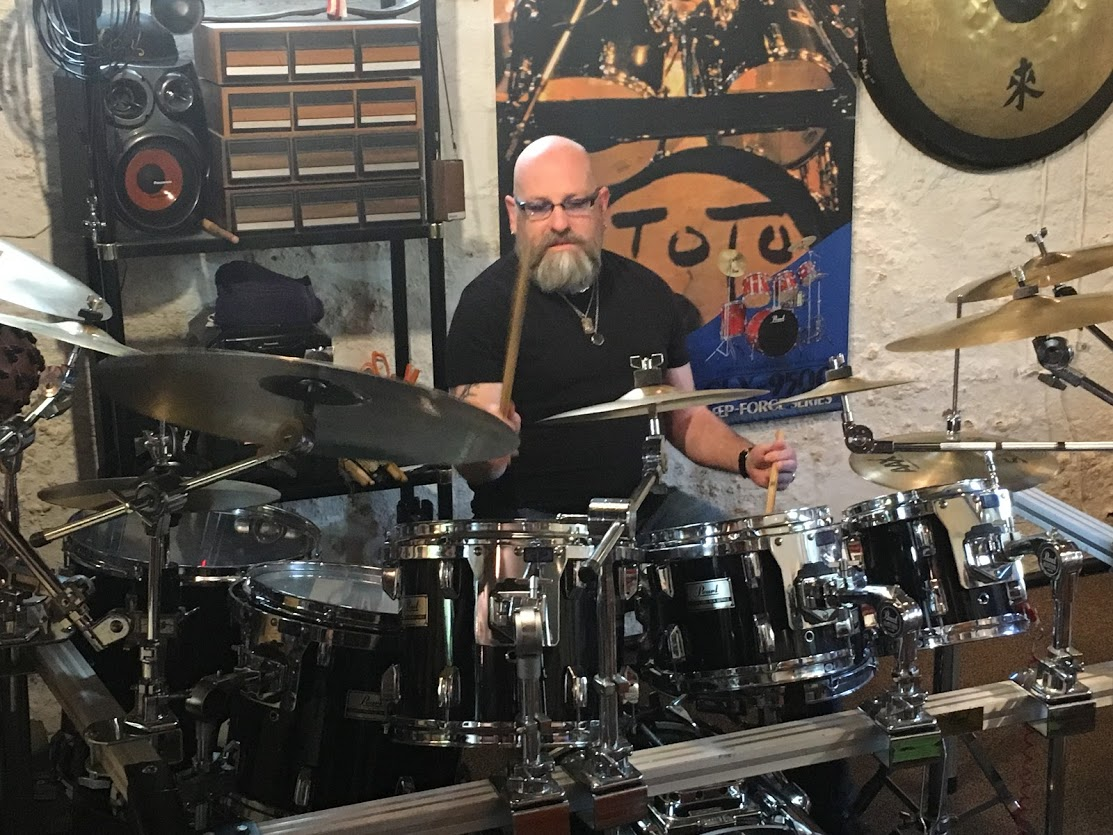 <p>Deep inside Worth's  Drum Studio  in his northeast Portland home, drums of every shape and size are stacked floor-to-ceiling. Drumsticks fill in the blank spaces between, glimmering in the glow of drum maker signs. (Stuart Tomlinson/KATU)</p>