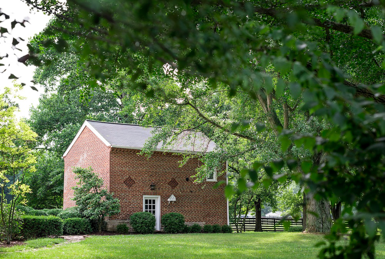 The Smokehouse nearby can accommodate up to four guests. Also freshly renovated, overnighters receive a welcome gift upon arrival, a sunset champagne toast, complementary tickets to the ArtWalk (an outdoor installation with video projections and synced soundscape), and room service provided by the Barn8 Farm Kitchen & Bourbon Lounge. / Image courtesy of Hermitage Farm // Published: 1.5.21