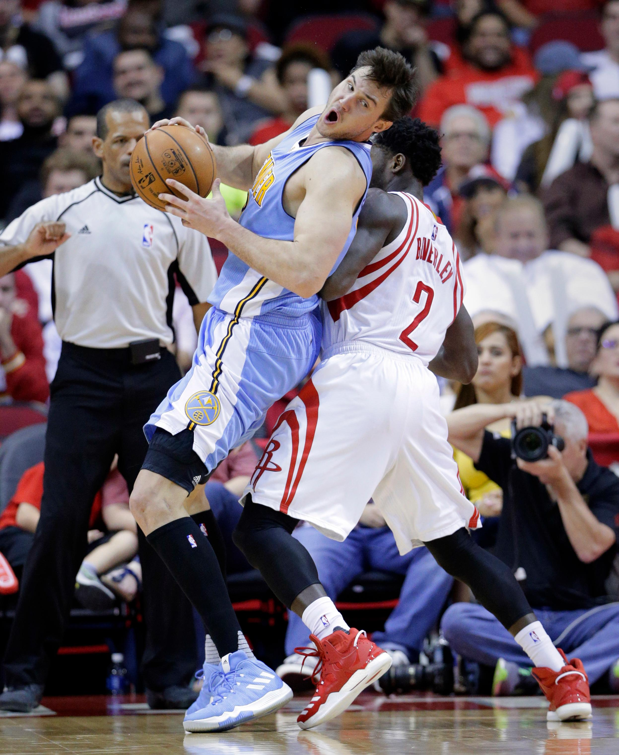 Denver Nuggets' Danilo Gallinari (8) drives around Houston Rockets' Patrick Beverley (2) in the second half of an NBA basketball game, Wednesday, April 5, 2017, in Houston. (AP Photo/Michael Wyke)